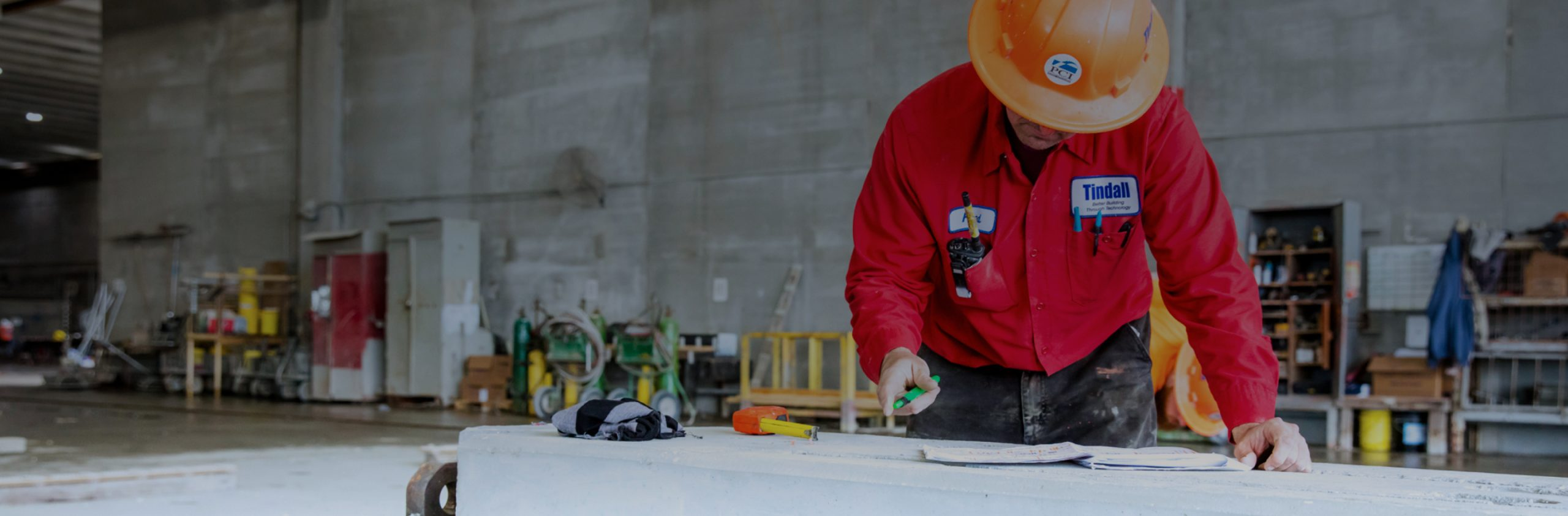 Tindall worker working on plans for a precast concrete construction project